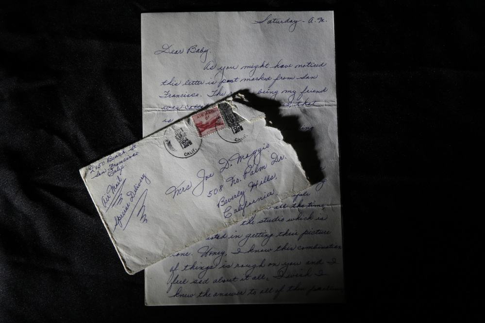 This photo shows part of a three-page handwritten letter and original envelope postmarked Oct. 9, 1954 from baseball legend Joe DiMaggio to Marilyn Monroe on display at Julien's Auctions in Beverly Hills, Calif.