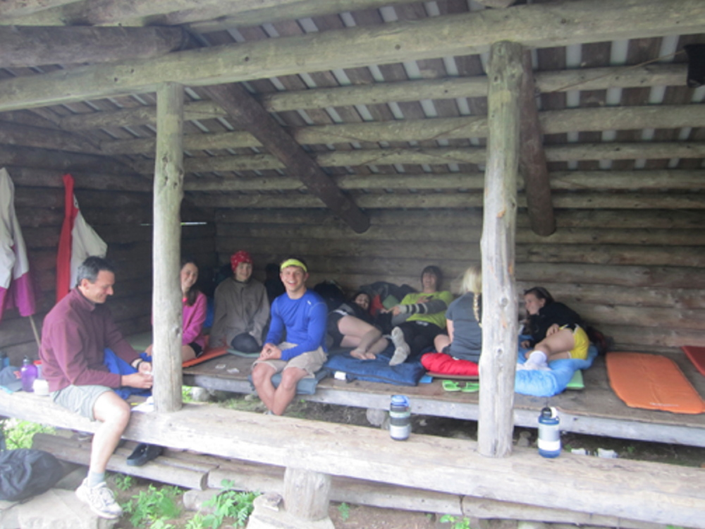 Monmouth Academy Outing Club resting in a shelter after a long day outside. From left are Chris Bryant, Becky Bryant, Emily Levasseur, Stewart Buzzell, Hanna Kerrigan, Garrick Ridlon, Anna Kulinski and Kaitlin Kerrigan.
