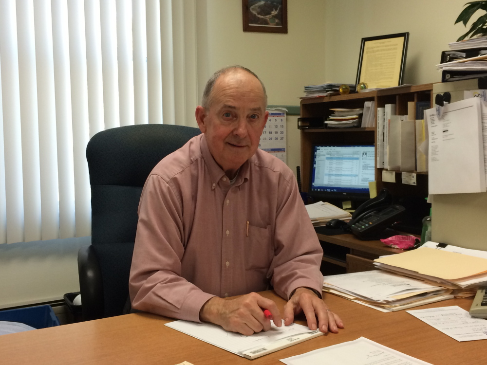 Madison Town Manager Dana Berry, at his desk in October, has retired, and a new town manager will be in place by January.