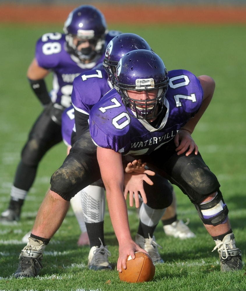 Waterville Senior High Schoo's center, Ben Cox, prepared to snap the ball to quarterback AJ Godin (7) during a recent game. Cox' brother Tom was a Waterville captain in 2012.
