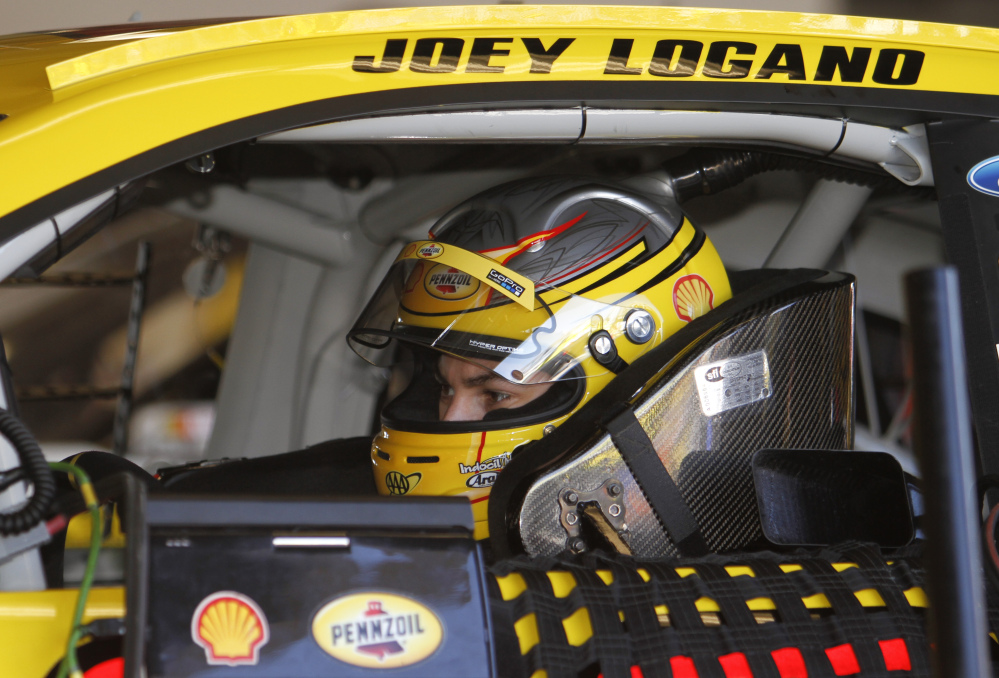 Joey Logano waits in his car to practice for the Daytona 500 earlier this season. Logano, Ryan Newman,  Kevin Harvick and Denny Hamlin have their share of tangled histories to get within reach of what will be the first NASCAR title for Sunday's winner.