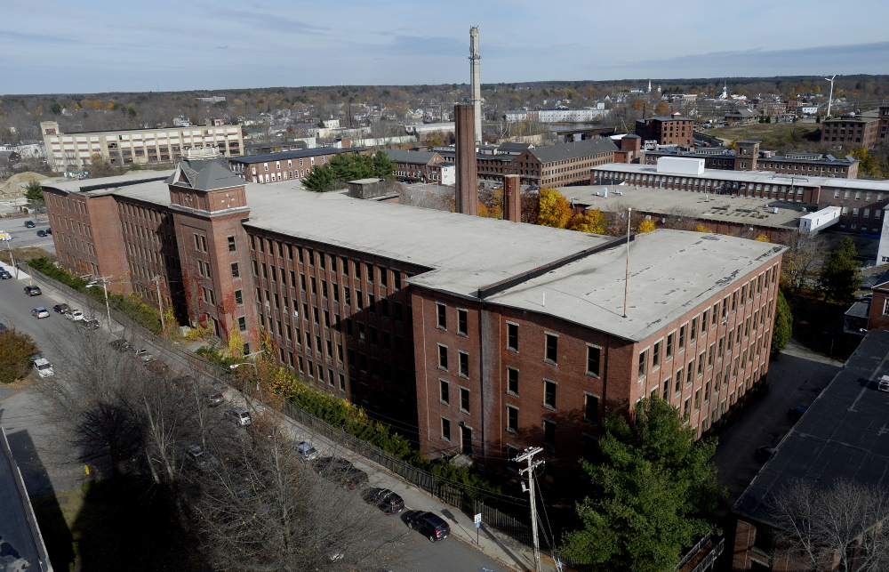 """Biddeford officials on Thursday announced a $50 million private redevelopment plan to turn the historic Lincoln Mill into 101 apartments, a hotel and restaurants. The investment in the city's downtown mill district """"is a direct result of the elimination of Maine Energy"""" last year, said Mayor Alan Casavant."""