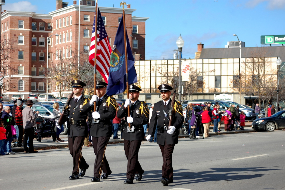 Photo by Heidi Stewart The Winslow Police Honor Guard marched in the Veterans Day parade. From left are Sgt. Haley Fleming, Ofiicer Brandon Lund, Reserve Officer Charles Theobald and Officer Bradley Hubert.