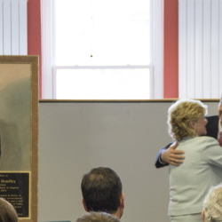 Former President Handley and current UMA President Glenn Cummings, with the plaque and sign that will hang inside the hall in the background.