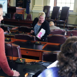 Rep.-elect Charlotte Warren, D-Hallowell, center, chats with fellow new House members Gina Melaragno, D-Auburn, left, and Heidi D. Brooks, D-Lewiston, during orientation day events for new members of the Legislature on Thursday at the State House in Augusta.