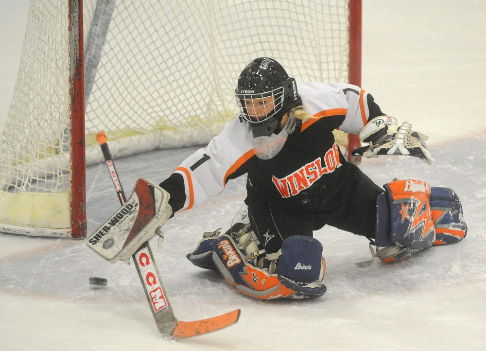 Staff photo by Michael G. Seamans   Winslow High School goalie Kiana Richards makes a save during a practice Thursday at Sukee Arena in Winslow.