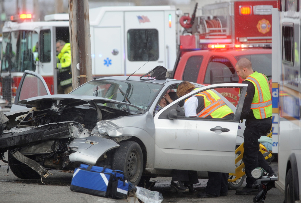 Waterville fire department and Delta Ambulance work to extricate Heather Wadsworth from her car after she collided with another vehicle as she pulled out of Oak Street onto College Avenue in Waterville on Friday.