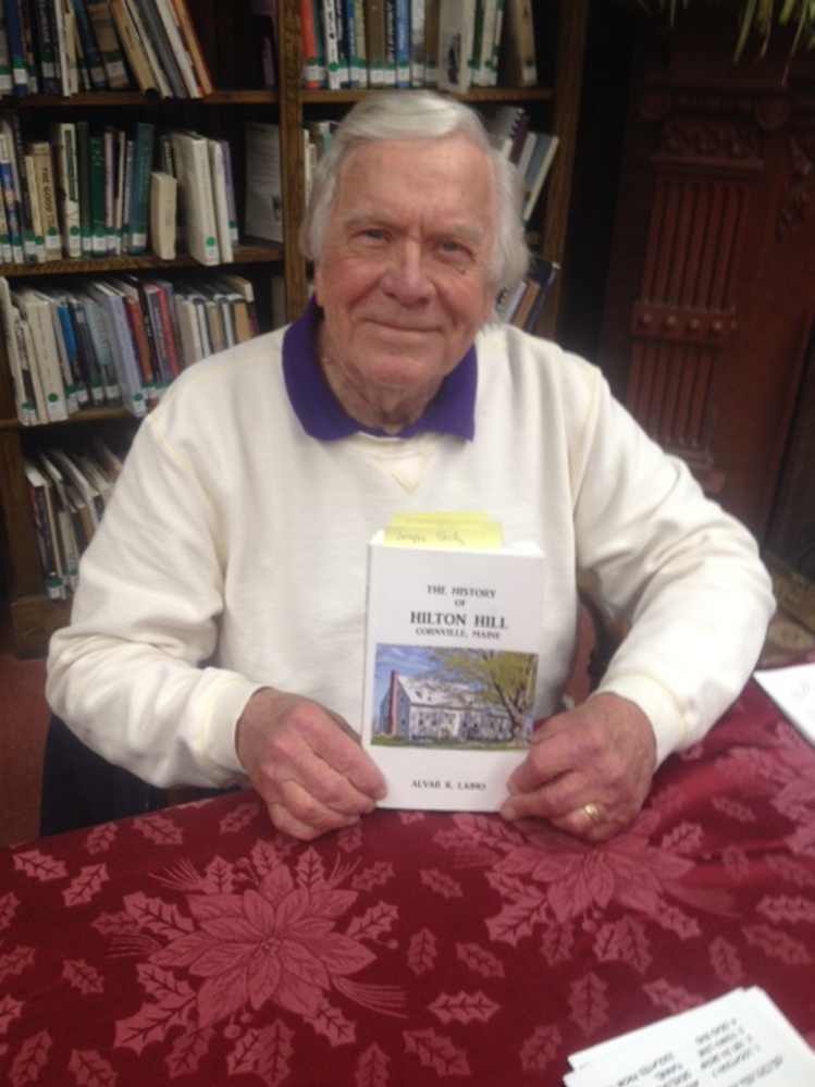 "Alvar Laiho, with his self-published book ""The History of Hilton Hill, Cornville, Maine,"""