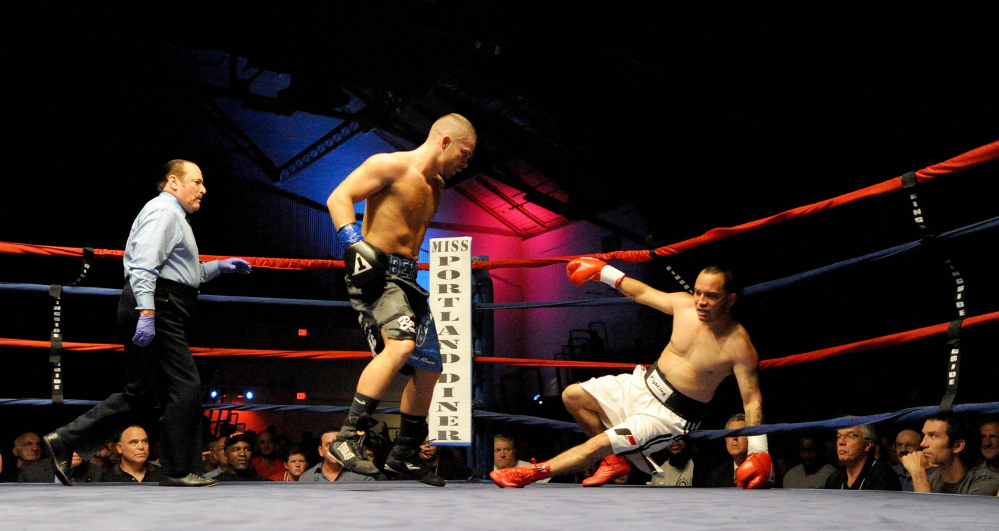"""Staff photo by Michael G. Seamans   Brandon """"The Cannon"""" Berry knocks down Moises Rivera in the 4th round of a June 14 bout at the Portland Expo. Berry defeated Rivera in 4 rounds by TKO."""