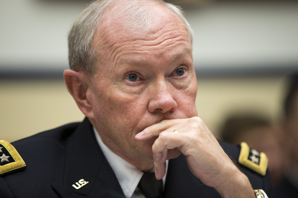 Joint Chiefs Chairman Gen. Martin Dempsey made a surprise visit to Iraq on Saturday, his first since a U.S.-led coalition began launching airstrikes against the extremist Islamic State group.