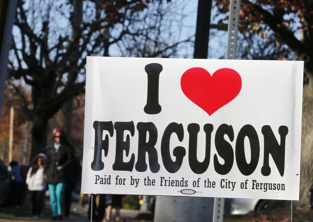 A sign is seen on a street before the verdict by the grand jury in the indictment of Darren Wilson, in Ferguson, Missouri, on Saturday. The grand jury decision on whether to indict the white Missouri police officer, Wilson, for fatally shooting a 18-year-old unarmed black teenager, Michael Brown, is nearing.