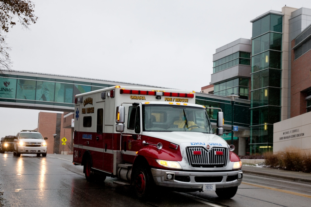 An ambulance transports Dr. Martin Salia, a surgeon working in Sierra Leone who had been diagnosed with Ebola, to the Nebraska Medical Center in Omaha, Neb., Saturday.