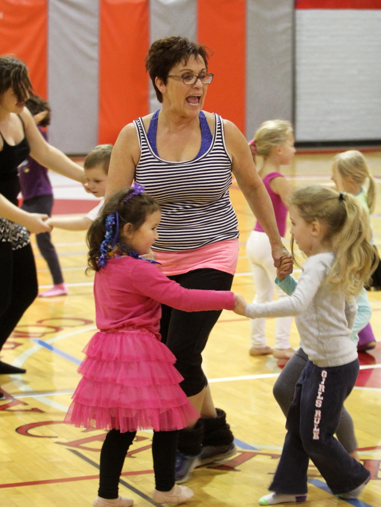 Farmington Postmaster Sue Jones leads a dance rehearsal at the Farmington Community Center on Saturday. This will mark the second year Jones has directed a free show in Farmington which will take place at the Farmington Community Center on Dec. 6 at 4 p.m. followed by a smaller second production at North Street Church at 6 p.m.