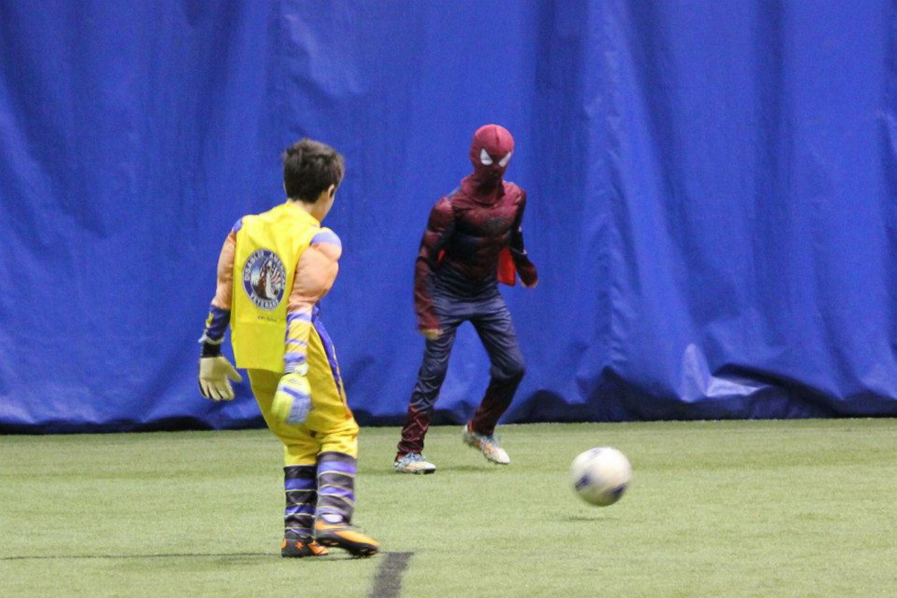 Team members play in the tournament.