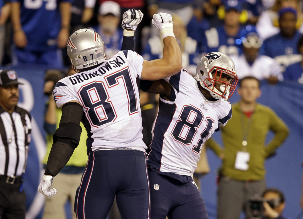 New England Patriots tight end Tim Wright, right, celebrates his touchdown catch with teammate Rob Gronkowski during the second half Sunday night against the Indianapolis Colts in Indianapolis. The Patriots won 42-20 and have an 8-2 record.