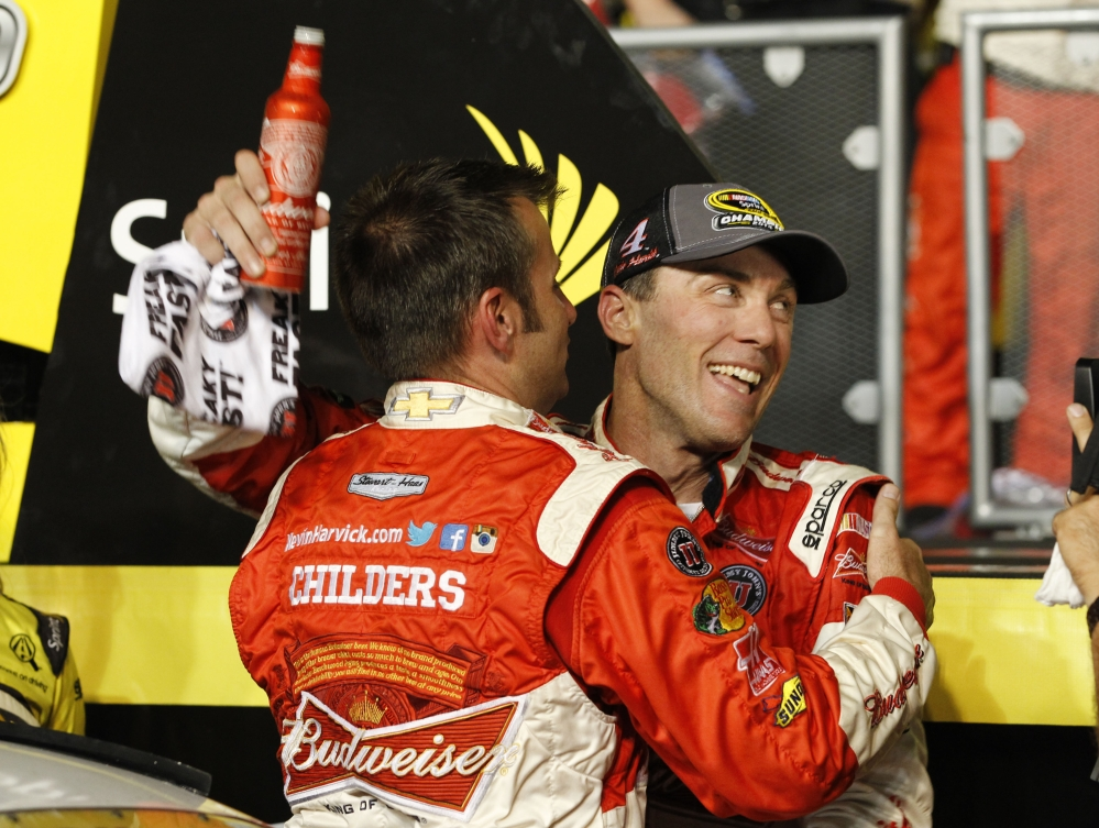 Kevin Harvick celebrates winning the NASCAR Sprint Cup championship Sunday in Homestead, Fla.