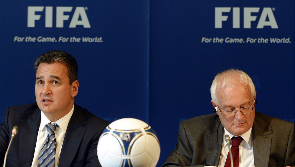 In this Friday, July 27, 2012 file photo, Chairmen of the two chambers of the new FIFA Ethics Committee Michael Garcia, left, from the US and Joachim Eckert, right, from Germany attend a press conference, at the Home of FIFA in Zurich, Switzerland.
