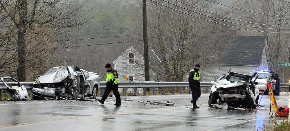 Police and firefighters investigate a two vehicle head-on crash on Tuesday on Eastern Avenue just east of Pleasant Hill Road in Augusta.