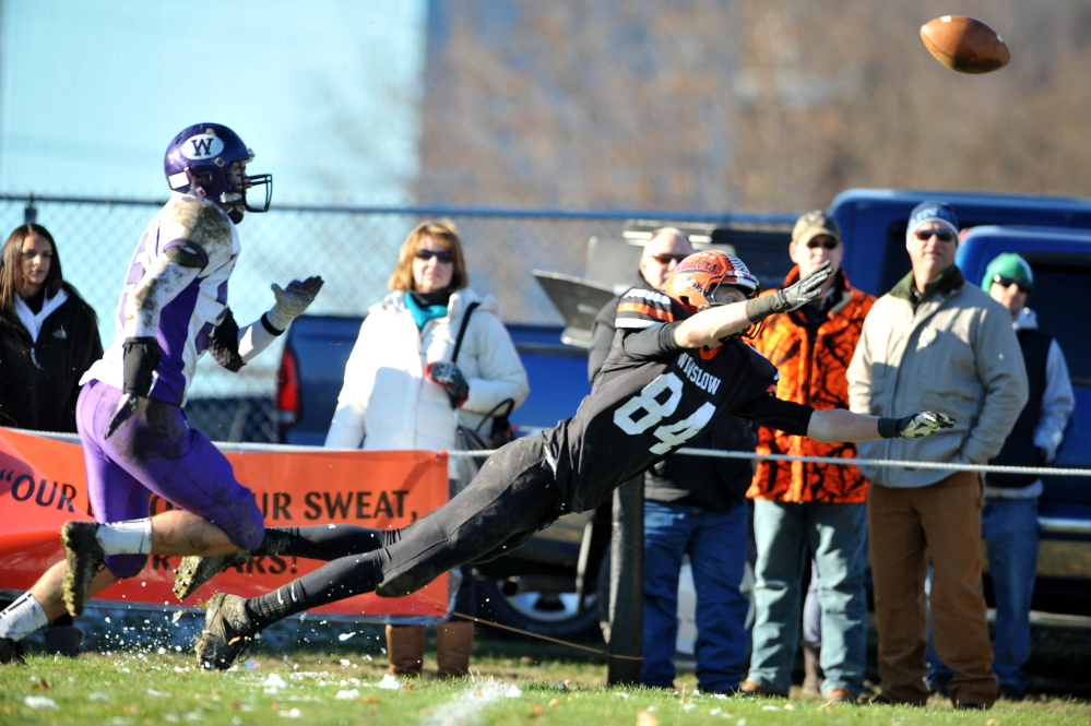 Winslow receiver Justin Martin, right, dives to try and catch a pass during the Eastern Class C title game against Waterville last weekend. Winslow will play Leavitt for the Class C state title Friday night at the University of Maine.