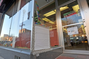 An unknown individual was captured on security surveillance breaking a window at Holy Cannoli on Main Street on Sunday.