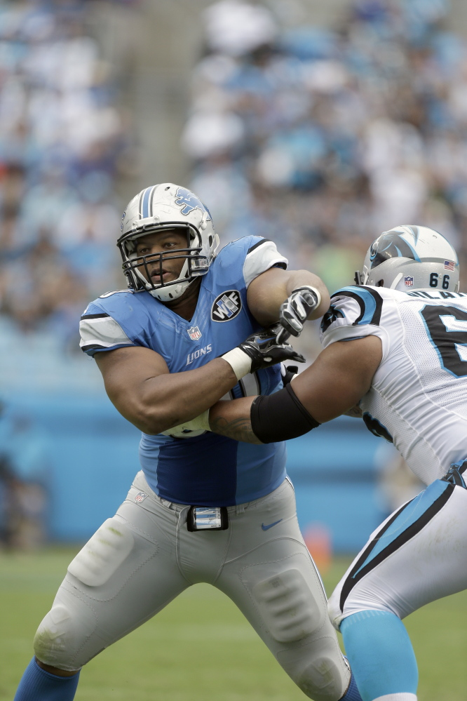Detroit Lions' Ndamukong Suh (90) rushes towards Carolina Panthers' Amini Silatolu (66) during the second half Sunday in Charlotte, N.C. The Lions play the New England Patriots on Sunday in Foxborough, Mass.