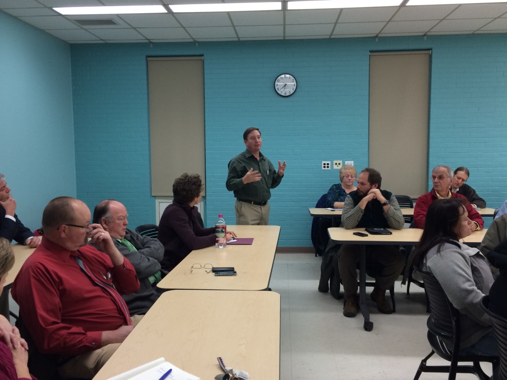 Bill Crandaw, program manager at Western Maine Community Action, speaking Wednesday in Farmington during a community forum on alternative energy, calls for the University of Farmington to start using wood pellets to heat the university campus.