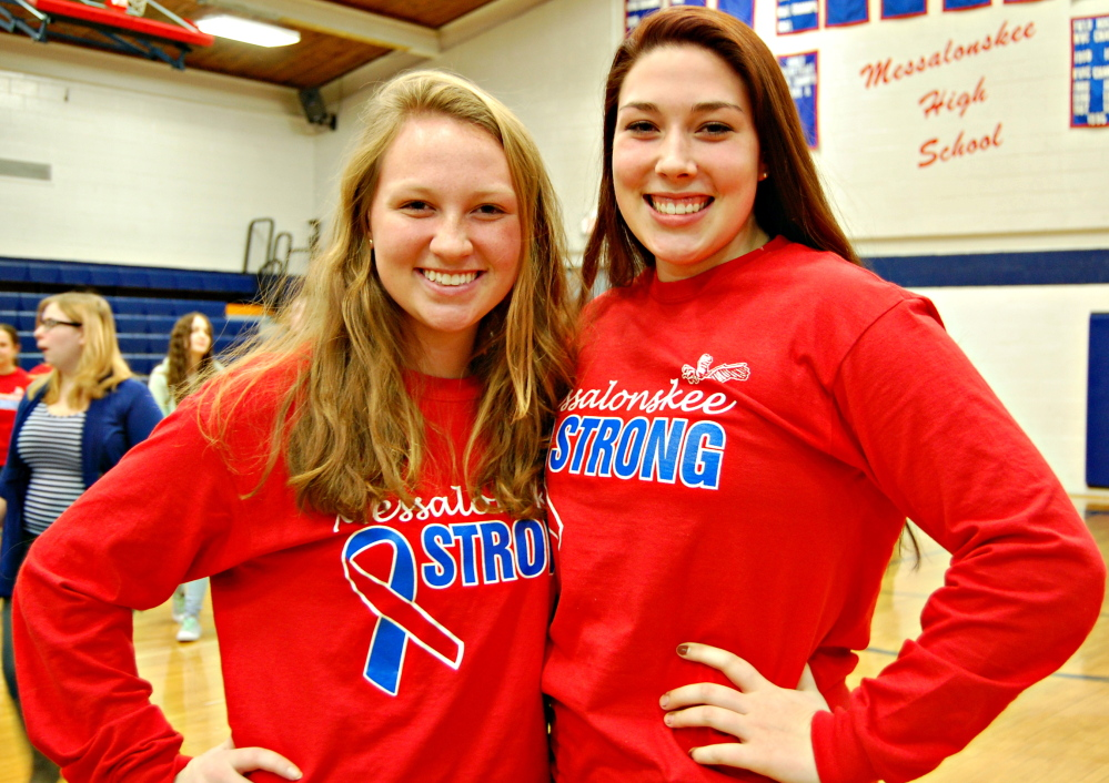 "Messalonskee High School students Camille Fontaine, left, and Sydni Collier wear ""Messalonskee Strong"" shirts. In the wake of a hayride accident that claimed the life of their fellow student, 17-year-old Cassidy Charette, the junior class began selling the shirts as a fundraiser with proceeds going to a scholarship fund started in Charette's honor."