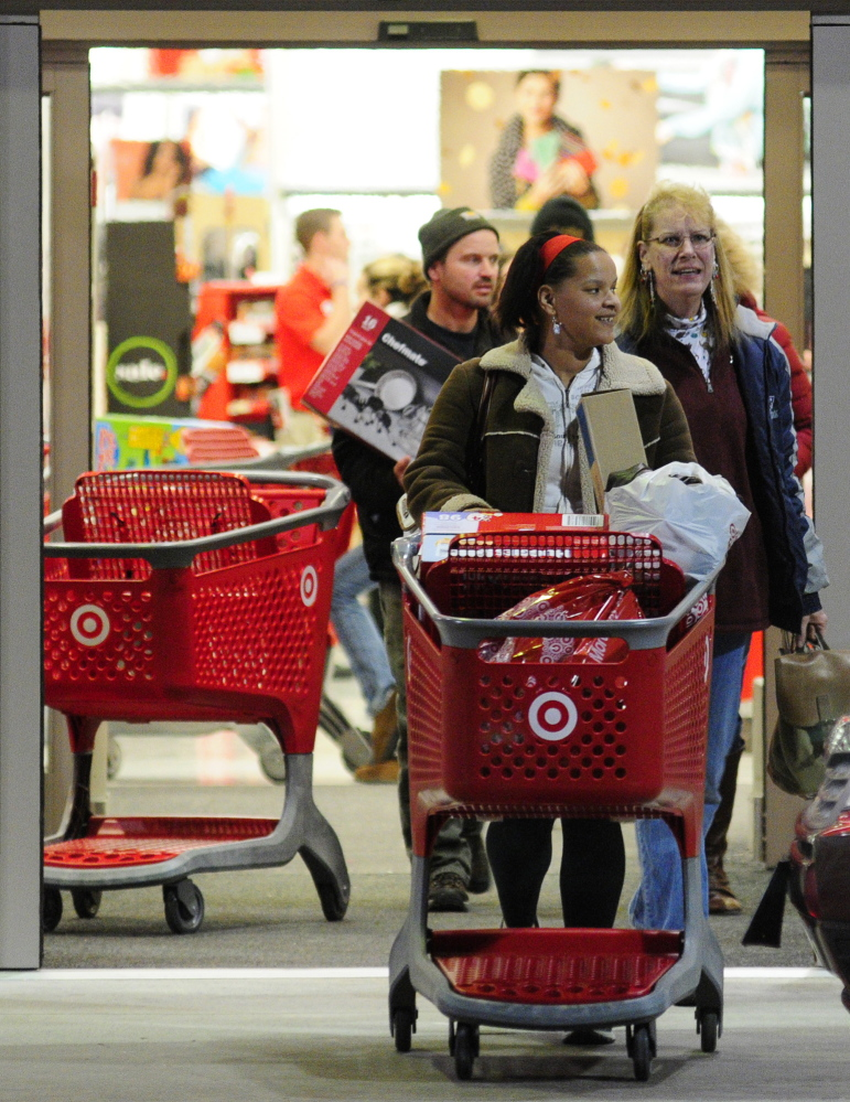 Shoppers roll carts out of the Target store at 5:07 a.m. on Black Friday last year in Augusta.