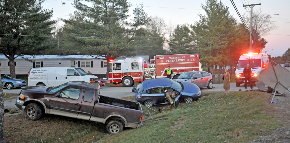 Firefighters from Waterville fire department, paramedics from Delta Ambulance and Waterville police respond to the scene of a three-car accident at Jacobs Drive and West River Road on Wednesday.
