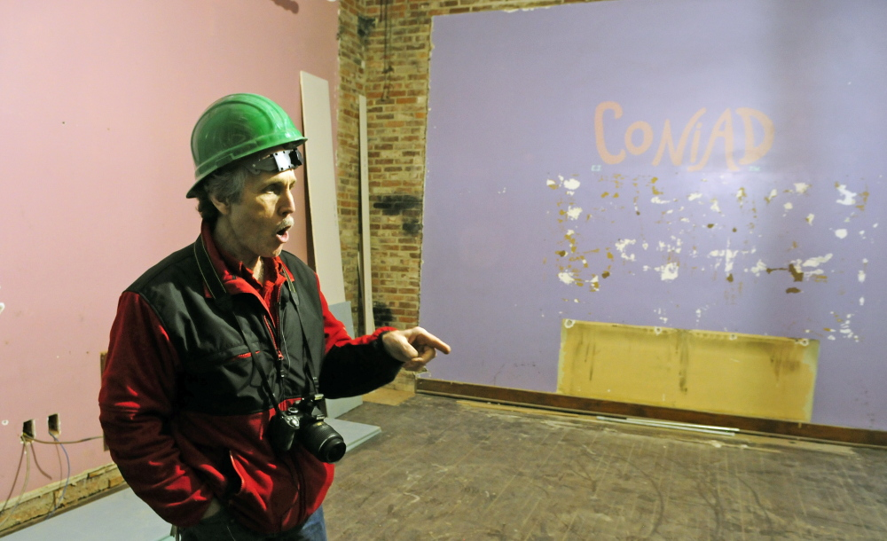 Cony High School teacher Tom Wells talks about where the darkrooms were in the Coniad, the Cony yearbook's office, during a tour on Friday of the Cony flatiron building in Augusta. The former high school on Cony Circle is being renovated into apartments.