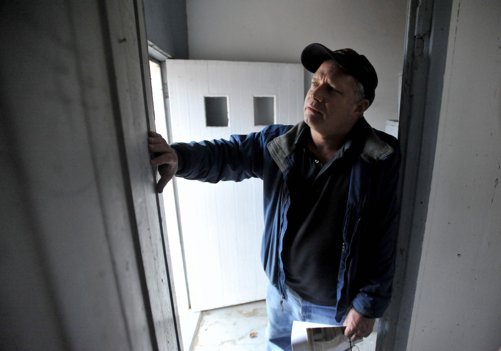 Winslow Councilman Raymond Caron, District 4, a former member of the now defunct Winslow Historical Society stands inside the historic Winslow schoolhouse on Wednesday.