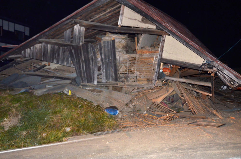 A house is collapsed after a strong earthquake hit in Hakuba, Nagano Prefecture, central Japan, on Saturday.