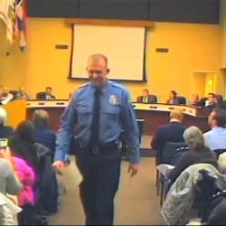 In this  Feb. 11, 2014 file image from video provided by the City of Ferguson, Mo., officer Darren Wilson attends a city council meeting in Ferguson. Wilson is not expecting to face criminal charges from a Missouri grand jury that has been investigating the nationally watched case for the past several months, a police union official said Thursday.