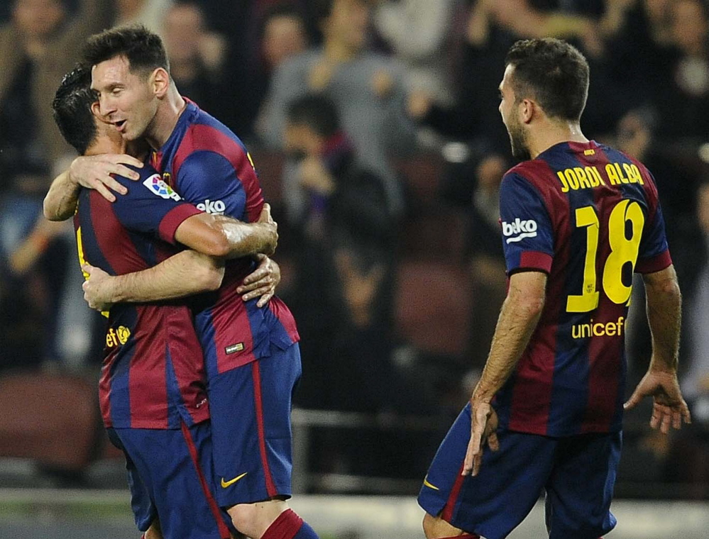 FC Barcelona's Lionel Messi, second left, celebrates with teammates after scoring against Sevilla during a Spanish La Liga soccer match at the Camp Nou stadium in Barcelona, Spain, on Saturday.