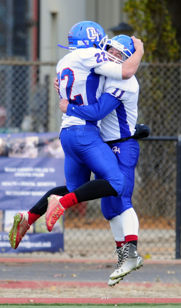 Oak Hill's Alex Mace, left, gets hugged by Jonah Martin after Mace scored on an 80-yard touchdown pass play.