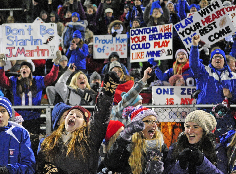 Oak Hill Raider fans celebrate their team's  41-21 victory over MCI in the Class D State Football Championship game on Saturday in Portland.