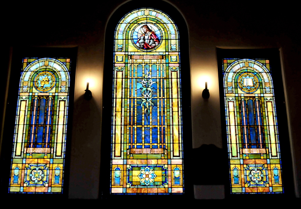 Some of the large stained-glass windows in the Madison Congregational Church.
