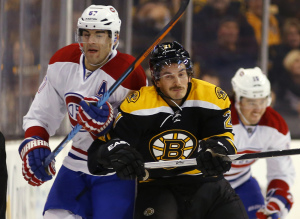 Boston Bruins' Loui Eriksson, front right, checks Montreal Canadiens' Max Pacioretty during the first period Saturday in Boston. Montreal won 2-0.