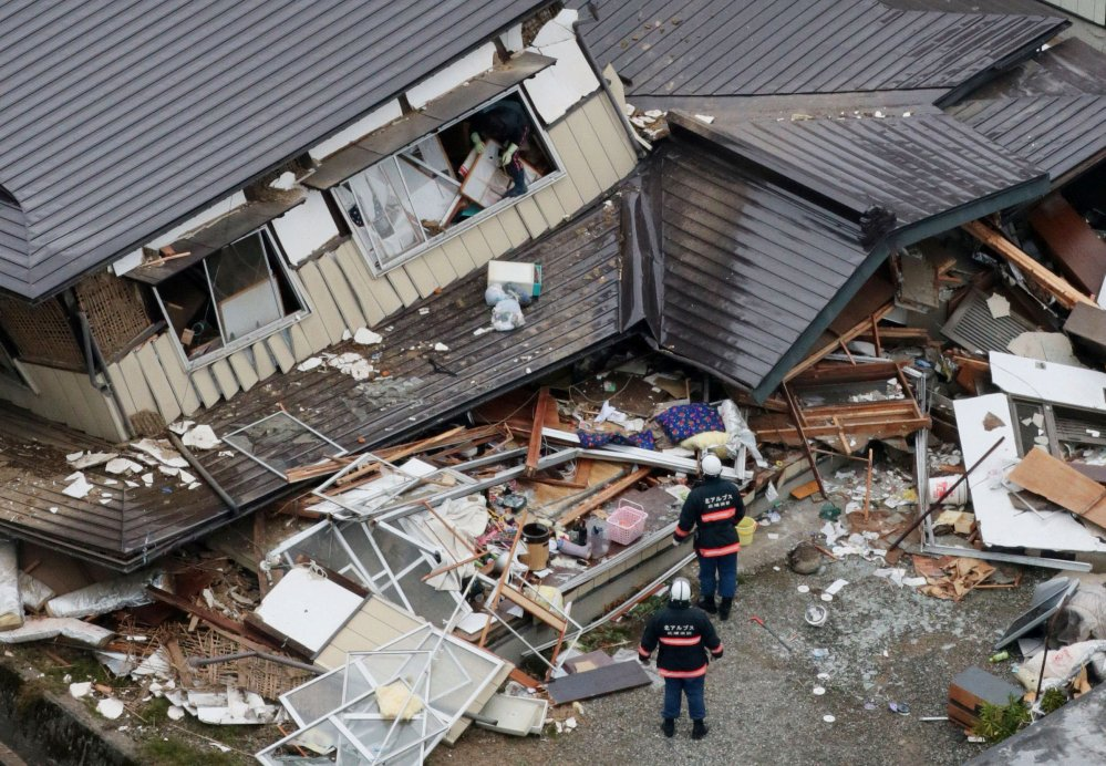 This aerial photo shows collapsed houses after a strong earthquake hit Hakuba, Nagano prefecture, central Japan, on Sunday. The magnitude-6.7 earthquake shook on Saturday night the mountainous area that hosted the 1998 Winter Olympics destroying more than half a dozen homes in the ski resort town.
