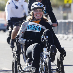 Former U.S. Rep. Gabrielle Giffords arrives back at the finish line for the 12-mile fun ride at the Special Olympics El Tour de Tucson bicycle race on Saturday in Tucson, Ariz..