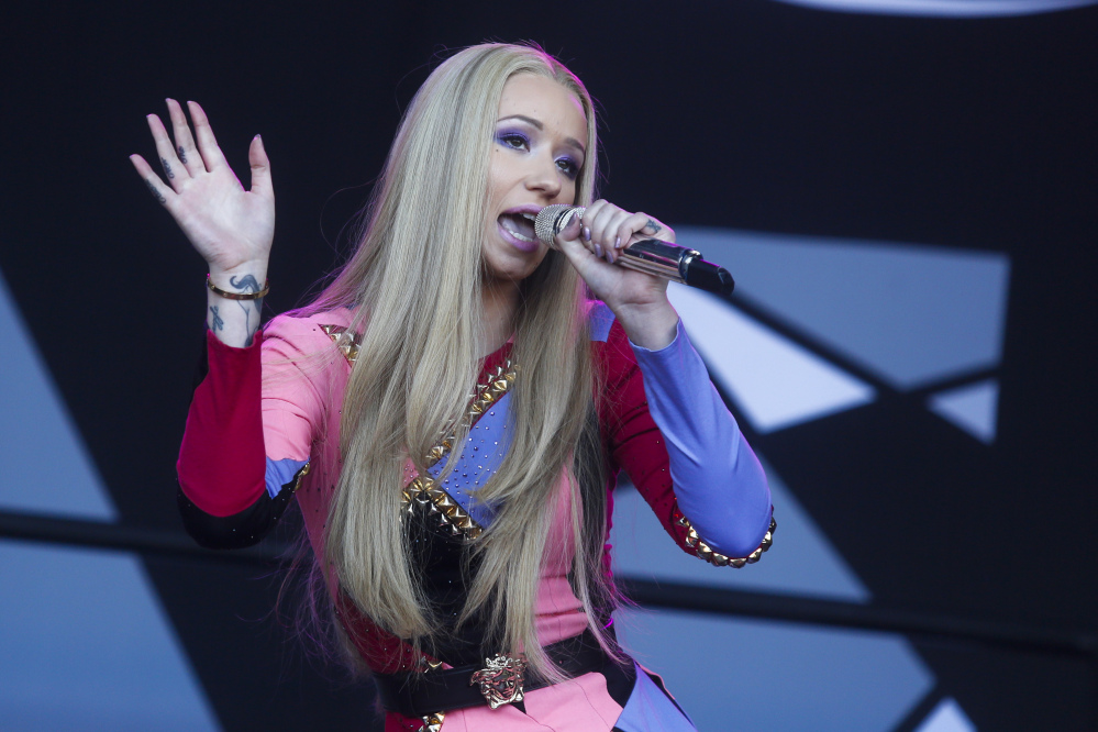 "Iggy Azalea, from Australia, is the lead nominee at Sunday's American Music Awards. She will compete for top awards such as artist, new artist and single of the year for her smash hit, ""Fancy."""