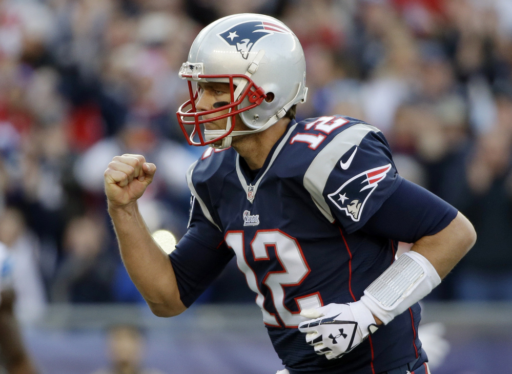 Patriots quarterback Tom Brady celebrates his second touchdown pass to Timothy Wright in the first half Sunday against the Detroit Lions at Gillette Stadium in Foxborough, Mass.