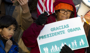 Supporters of immigration reform attend a rally in front of the White House in Washington, Friday, thanking President Obama for his executive action on illegal immigration.