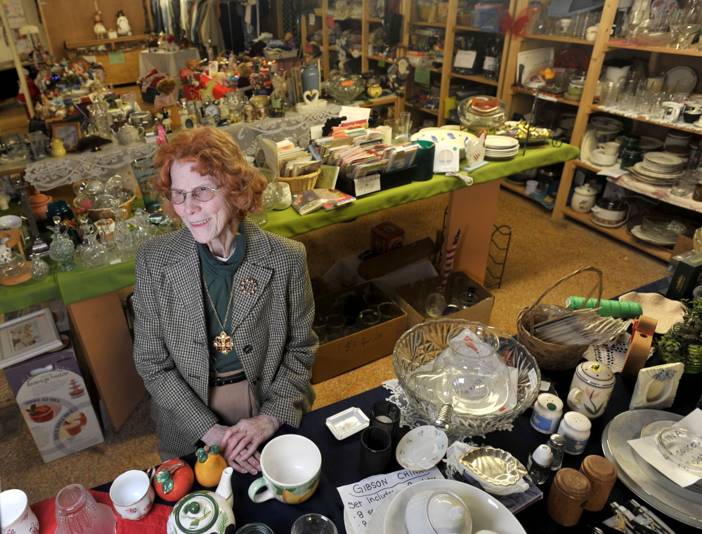 WATERVILLE, MAINE - NOVEMBER 21, 2014.   Essie Golden, of Bingham, among the donated merchandise at the resale shop at Hospice Volunteers of Waterville Area on Main Street on Friday, Nov. 21, 2014. (Staff photo by Michael G. Seamans)
