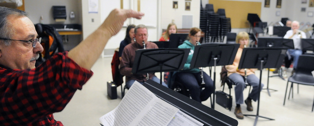 Charles T. Milazzo conducts members of the Kennebec Performing Arts Company during rehearsal Tuesday in Augusta.