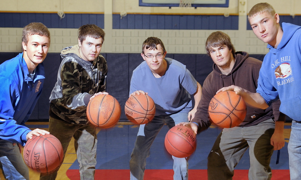 Oak Hill High School students, from left, Dalton Therrien, Logan Montminy, Sam Guilford, Garrett Gile and Levi Buteau, dribble in the school's gym earlier this month. The group participated in a unified tournament at the University of Southern Maine last spring.
