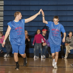 Members of an Oak Hill Special Olympics basketball team congratulate each other during a game in the Southern Maine Unified Basketball Tournament in April 2013 at the University of Southern Maine.