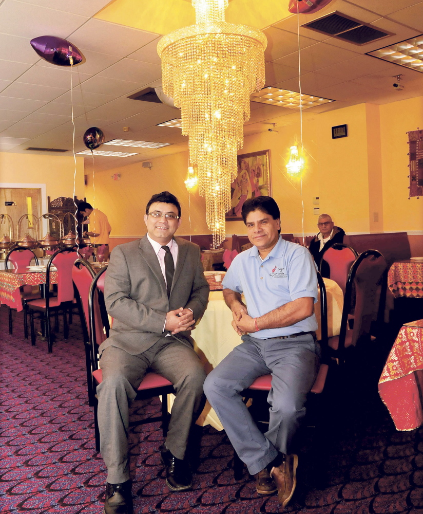 Rishi Malik, left, and Prem Sharma, manager and owner of Waterville's newest downtown restaurant, bring a departure from mainstream cuisine to the downtown with their Indian fare, a move local leaders hope will help make the city a destination for central Maine diners.