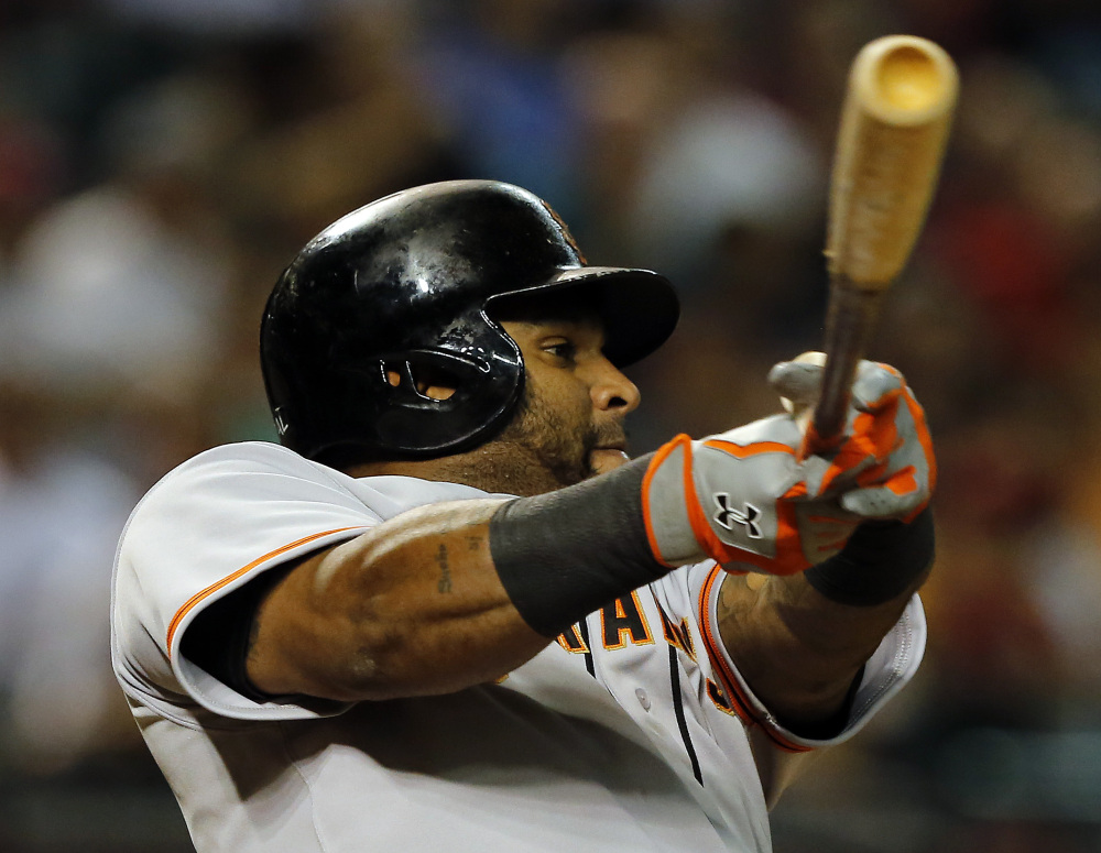 In this Sept. 16, 2014, file photo, San Francisco Giants third baseman Pablo Sandoval (48) bats against the Arizona Diamondbacks in the seventh inning during a baseball game in Phoenix.