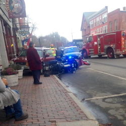 A Subaru wagon backed onto a sidewalk in downtown Hallowell Tuesday afternoon.